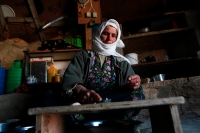 Hajeh Nuzha prepares food for her family. Nuzha's husband was killed by a settler and she is now running the household with the help of her sons and their wives. Sha'eb el Buttom, January 2012. Photo: Tomer Appelbaum