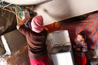 Washing machines save hours of manual work and allow the women to spend more time with the small children. Sha'eb el Buttom, January 2012. Photo: Tomer Appelbaum